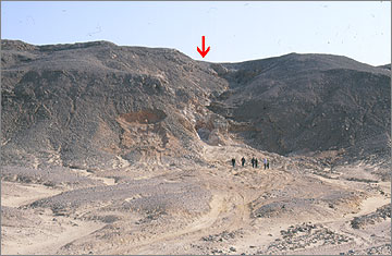 The site of Stela S, now a hole in the hillside, is beneath the red arrow