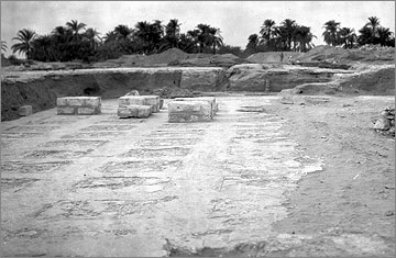Excavation photograph (1932) towards the front of the Long Temple, looking west, where the foundations of a few of the offering-tables were preserved. The preserved parts would have been buried beneath the fill beneath the temple pavement