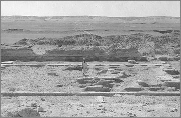 Excavation photograph (1932) of the rear part of the Sanctuary of the Great Aten Temple, viewed towards the east and showing the remains of the gypsum foundation layer.