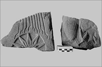 Two fragments of carved quartzite, part of the decoration of the Great Palace. Left (35/227): Aten rays above lotus plant; right (35/263): princess holding sistrum behind the figure of Nefertiti