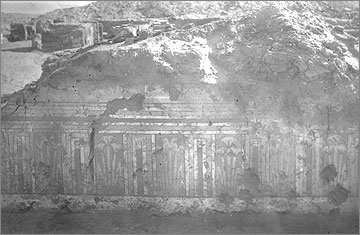 Excavation photograph (1931) of a length of wall in the King's House and its painted dado