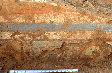 Painted wall-plaster from a dado still preserved behind a bank of sand (temporarily removed in 1993)