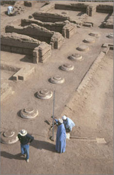 The repairs to the garden court of the North Palace. The row of column bases has been completed by the insertion of casts into the gaps left by the loss of some of the original bases