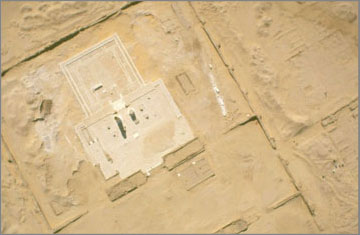 Aerial photograph of the Sanctuary of the Small Aten Temple at the completion of the laying out of the Sanctuary outline in new limestone blocks. The new stone flooring of the gateways between the pylons had not been completed when the photograph was taken.