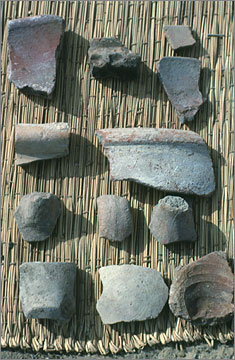 A collection of sherds derived from rims, handles and bases, and therefore diagnostic of the original shape of the vessel