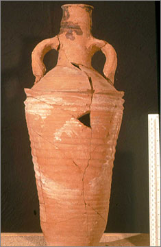 An amphora, made in Egypt, from the monastery at Kom el-Nana (catalogue no. 444). Traces of pitch or resin are present on the rim and neck. Broad 'swags' have been added in cream paint. 5th or 6th century AD.